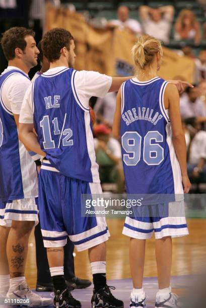 """Justin Timberlake 1/2 and Cameron Diaz wearing jerseys that say """"Me"""" and """"Sireatalot"""" at the NSYNC Challenge For The Children Celebrity Basketball..."""