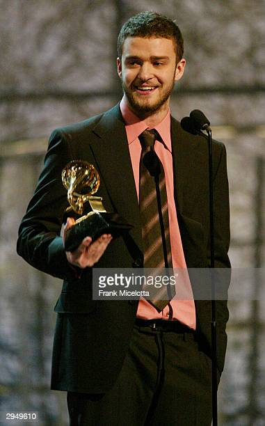 Justin Timberlake accepts the Grammy for Best Male Pop Vocal Performance for the song Cry Me A River on the album Justified at the 46th Annual Grammy...