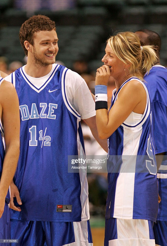 Justin Timberlake (L) and actress Cameron Diaz at the NSYNC Challenge For The Children Celebrity Basketball Game July 25, 2004 at Office Depot Center in Sunrise, Florida.