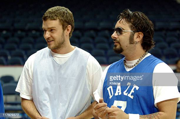 Justin Timberlake and Chris Kirkpatrick during *NSYNC's Challenge for the Children VII Celebrity Basketball Game at Allstate Arena in Chicago...
