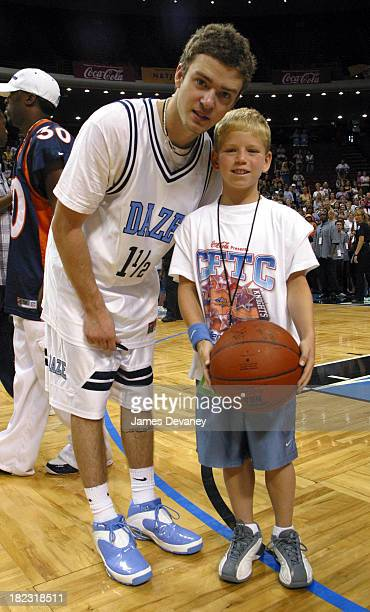 Justin Timberlake and fan during *NSYNC Challenge for the Children IV Celebrity Basketball Game at TD Waterhouse Centre in Orlando Florida United...