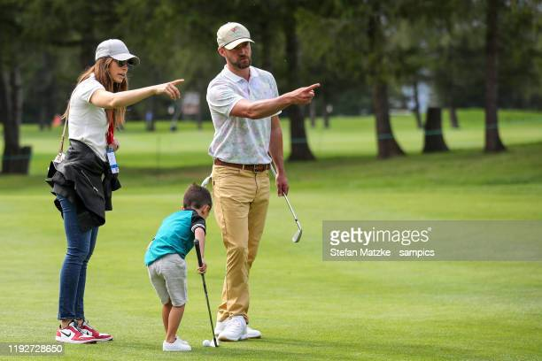 Justin Timberlake and his wife Jessica Biel talk to their son Silas ahead of the ProAm prior to the start of the Omega European Masters at at Crans...