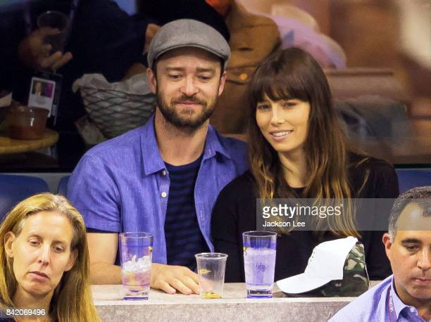 Justin Timberlake and Jessica Biel flirt with each other while cheering on the players Federer vs Lopez at Arthur Ashe Stadium on September 2 2017 in...