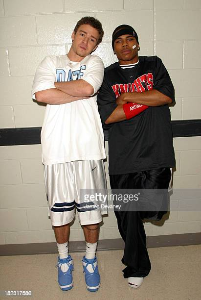 Justin Timberlake and Nelly during *NSYNC Challenge for the Children IV Celebrity Basketball Game at TD Waterhouse Centre in Orlando Florida United...