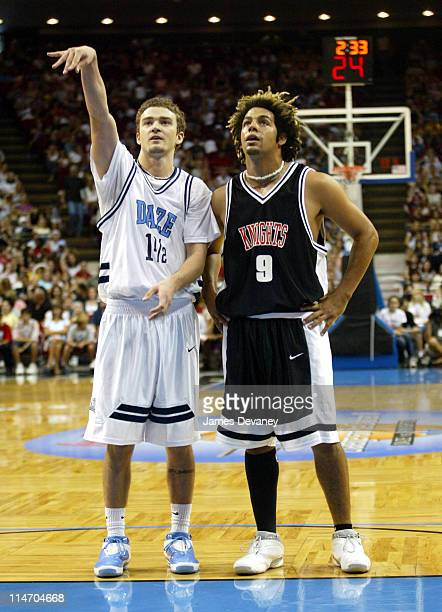 Justin Timberlake and Trevor Penick of OTown during *NSYNC Challenge for the Children IV Celebrity Basketball Game at TD Waterhouse Centre in Orlando...