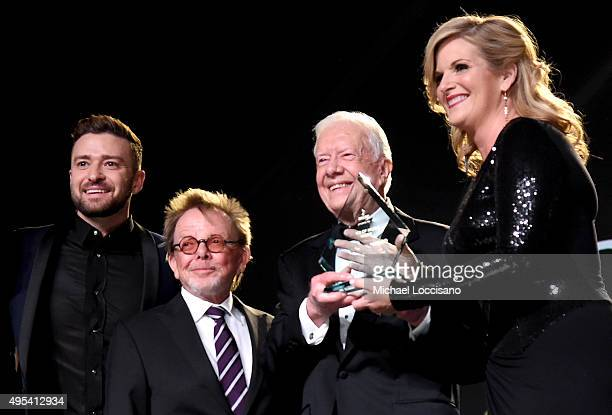 Justin Timberlake ASCAP President and Chairman of the Board Paul Williams and President Jimmy Carter present Trisha Yearwood with the Voice of Music...