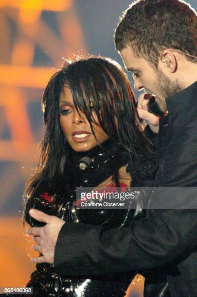 Justin Timberlake helps Janet Jackson cover her chest after it was exposed during her halftime performance at Super Bowl XXXVIII at Reliant Stadium,...