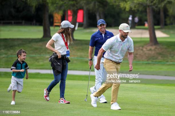 Justin Timberlake his wife Jessica Biel their son Silas and Rory McIlroy of Northern Ireland are seen ahead of the ProAm prior to the start of the...
