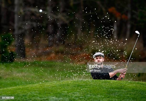 Justin Timberlake hits a bunker shot to the sixth green during the first round of the AT&T Pebble Beach National Pro-Am at the Spyglass Hill Golf...