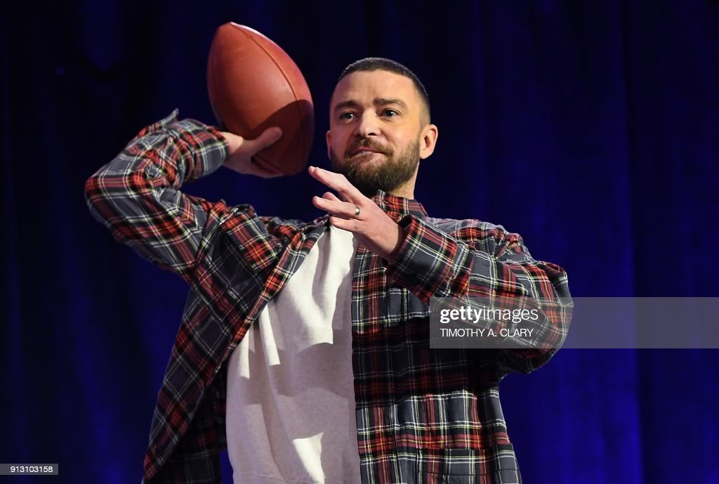 TOPSHOT - Justin Timberlake holds a football during the Pepsi Super Bowl LII Halftime Show press conference February 1, 2018 in Minneapolis, Minnesota. /