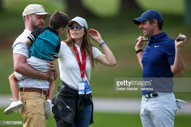 Justin Timberlake holds his son Silas whilst talking to his wife Jessica Biel and Rory McIlroy of Northern Ireland ahead of the ProAm prior to the...