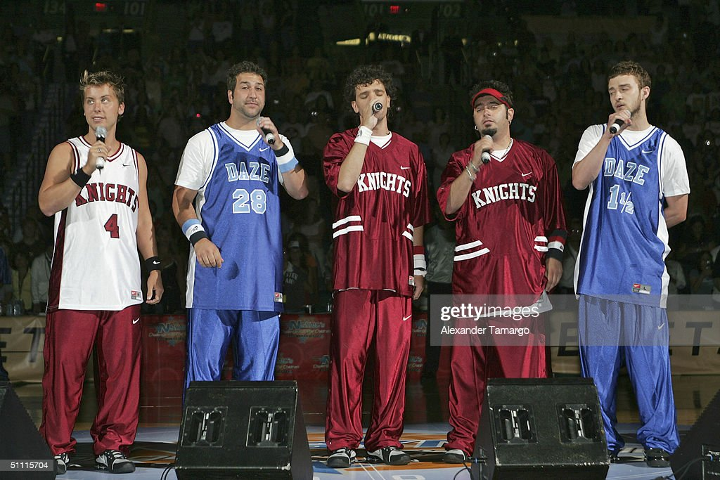 Justin Timberlake, Lance Bass, Joey Fatone, J.C. Chasez and Chris Kirkpatrick as NSYNC perform the National Anthem during the NSYNC Challenge For The Children Celebrity Basketball Game at the Office Depot Center on July 25, 2004 in Sunrise, Florida.