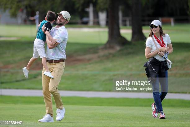 Justin Timberlake lifts up his son Silas next to his wife Jessica Biel ahead of the ProAm prior to the start of the Omega European Masters at at...