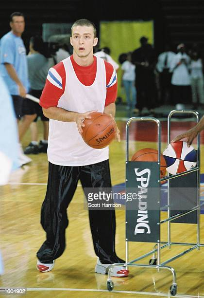 Justin Timberlake of N''Sync takes aim at a 3pointer during the pop band''s Challenge for the Children III charity event at the Thomas Mack Center in...