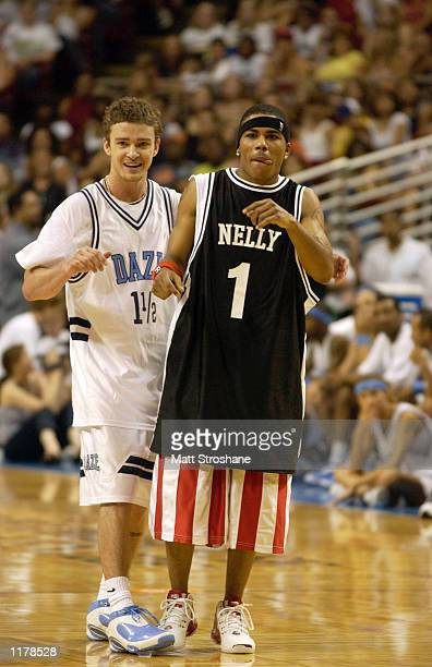Justin Timberlake of *NSYNC talks with rapper Nelly during the Challenge for the Children IV at the TD Waterhouse Center July 28 2002 in Orlando...