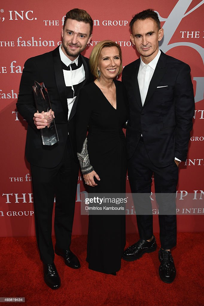 Justin Timberlake poses with his award and Lord & Taylor President Liz Rodbell, and Fashion Designer Neil Barrett at the 2015 Fashion Group International Night Of Stars Gala at Cipriani Wall Street on October 22, 2015 in New York City.