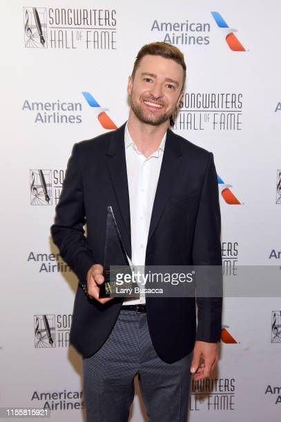 Justin Timberlake poses with the Contemporary Icon Award backstage during the Songwriters Hall Of Fame 50th Annual Induction And Awards Dinner at The...