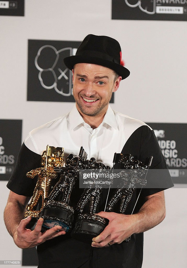 Justin Timberlake poses with Video of the Year award, Best Direction award, Best Editing award and Michael Jackson Video Vanguard award in the pressroom at the 2013 MTV Video Music Awards at the Barclays Center on August 25, 2013 in the Brooklyn borough of New York City.