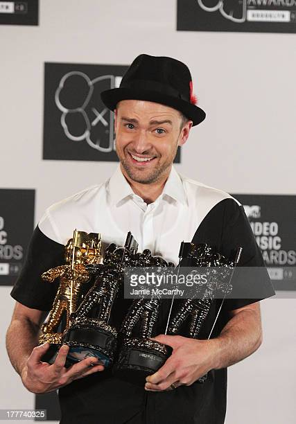 Justin Timberlake poses with Video of the Year award Best Direction award Best Editing award and Michael Jackson Video Vanguard award in the...