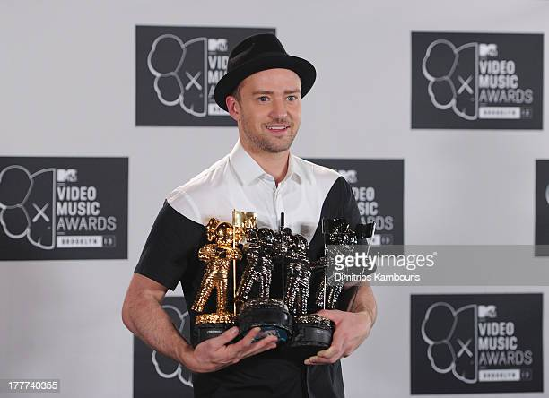Justin Timberlake poses with Video of the Year award Best Direction award Best Editing award and Michael Jackson Video Vanguard award in the press...