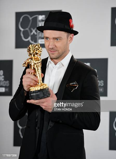 Justin Timberlake with the Michael Jackson Video Vanguard Award at the MTV Video Music Awards August 25 2013 at the Barclays Center in New York AFP...