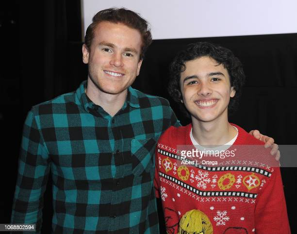 Justin Tinucci and cohost Hunter Payton pose together at the Hunter Payton And The Shoe Crew Holiday Charity Fundraiser Screening of Illumination's...