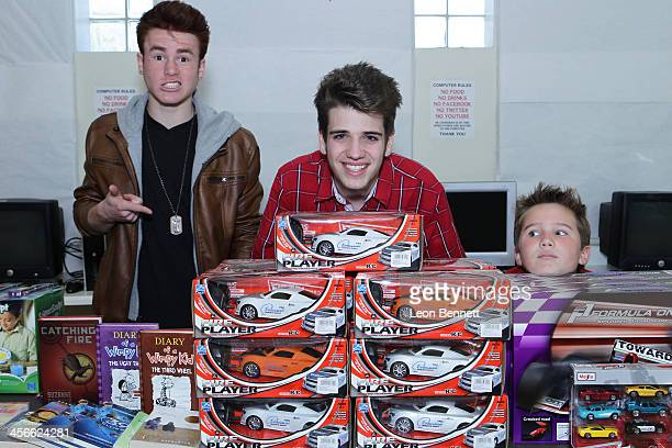 Justin Tinucci Brandon Tyler Russell and Tyler Champagne attend the Loma Alta Park's Festive 7th Annual Celebrity Christmas Toy Giveaway at Loma Alta...
