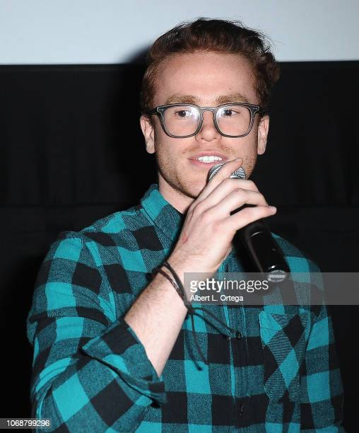 Justin Tinucci speaks to the audience at Hunter Payton And The Shoe Crew Holiday Charity Fundraiser Screening of Illumination's 'The Grinch'...