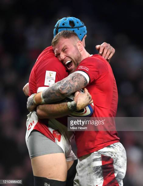 Justin Tipuric of Wales celebrates with teammate Ross Moriarty of Wales after scoring his sides first try during the 2020 Guinness Six Nations match...