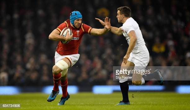 Justin Tipuric races past George Ford during the RBS Six Nations match between Wales and England at Principality Stadium on February 11 2017 in...