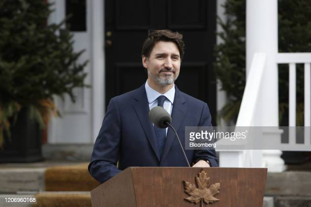 Justin Trudeau Canada's prime minister arrives to speak to members of the media outside of his residence at Rideau Cottage in Ottawa Ontario Canada...