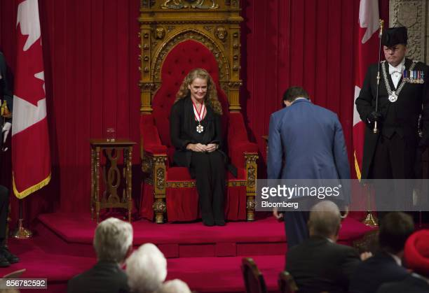 Justin Trudeau, Canada's prime minister, bows to Julie Payette, governor general-designate of Canada, while she is sworn in during an installation...