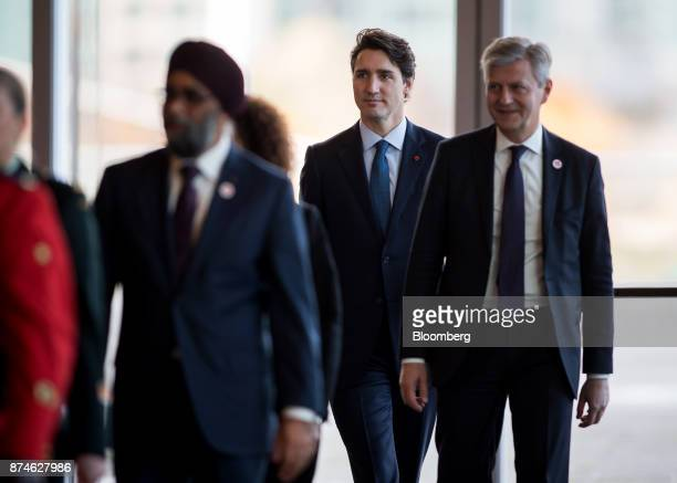 Justin Trudeau Canada's prime minister center and JeanPierre Lacroix undersecretarygeneral for peacekeeping operations at the United Nations right...