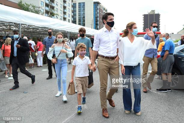 Justin Trudeau, Canada's prime minister, center right, visits the Parkdale Market with his wife Sophie Gregoire, right, and three children on Canada...