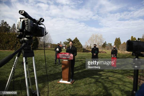 Justin Trudeau, Canada's prime minister, center, speaks during a news conference with Steven Guilbeault, Canada's heritage minister, from left,...