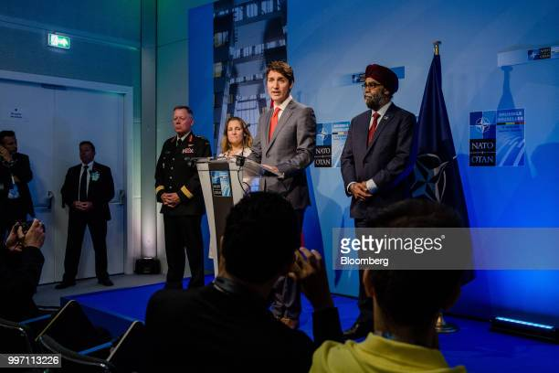 Justin Trudeau Canada's prime minister center speaks during a news conference with General Jonathan Vance Canada's chief of defense left Chrystia...
