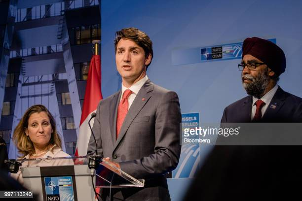 Justin Trudeau Canada's prime minister center speaks flanked by Chrystia Freeland Canada's minister of foreign affairs left and Harjit Sajjan Canadas...