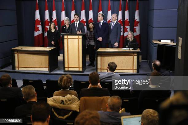 Justin Trudeau Canada's prime minister center speaks while Chrystia Freeland Canada's deputy prime minister from left Patty Hajdu Canada's health...