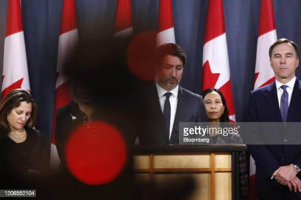 Justin Trudeau Canada's prime minister center speaks while Chrystia Freeland Canada's deputy prime minister from left Theresa Tam Canada's chief...