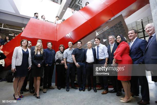 Justin Trudeau Canada's prime minister center stands for a group photograph following a tour of the Bayview Yards innovation center in Ottawa Ontario...