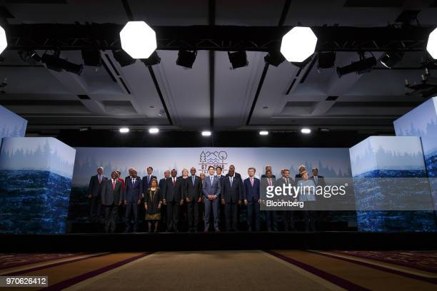 Justin Trudeau Canada's prime minister center stands with Outreach nation leaders for a family photograph following a working session at the Group of...