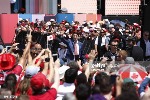 Justin Trudeau Canada's prime minister center waves at attendees while arriving to a Canada Day event on Parliament Hill in Ottawa Ontario Canada on...