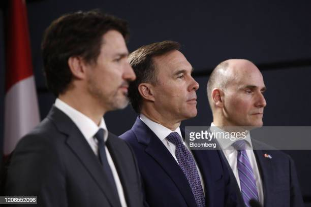Justin Trudeau Canada's prime minister from left Bill Morneau Canada's finance minister and JeanYves Duclos Canada's president of the treasury board...