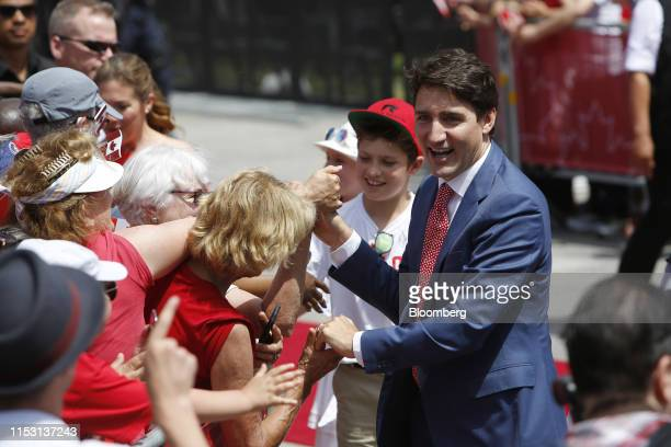 Justin Trudeau Canada's prime minister greets attendees while arriving to a Canada Day event on Parliament Hill in Ottawa Ontario Canada on Monday...