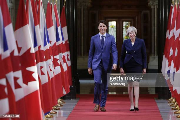 Justin Trudeau Canada's prime minister left and Theresa May UK prime minister walk down the Hall of Honour on Parliament Hill in Ottawa Ontario...