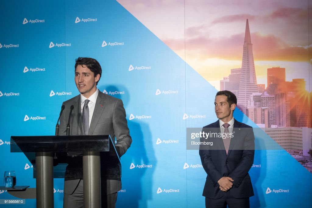 Justin Trudeau, Canada's prime minister, left, speaks as Daniel Saks, president and co-chief executive officer of AppDirect Inc., listens during a press conference in San Francisco, California, U.S., on Thursday, Feb. 8, 2018. Technology and innovation is at the center of Trudeau's economic vision for Canada, so his visit to San Francisco is as much about symbolism as it is about drumming up new business. Photographer: David Paul Morris/Bloomberg via Getty Images