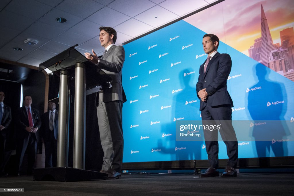 Justin Trudeau, Canada's prime minister, left, speaks during a press conference with Daniel Saks, president and co-chief executive officer of AppDirect Inc., in San Francisco, California, U.S., on Thursday, Feb. 8, 2018. Technology and innovation is at the center of Trudeau's economic vision for Canada, so his visit to San Francisco is as much about symbolism as it is about drumming up new business. Photographer: David Paul Morris/Bloomberg via Getty Images