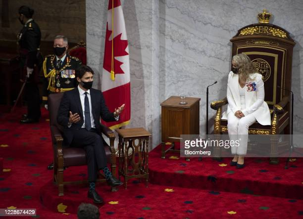 Justin Trudeau, Canada's prime minister, left, speaks with Julie Payette, Canada's governor general, prior to the Throne Speech on Parliament Hill in...