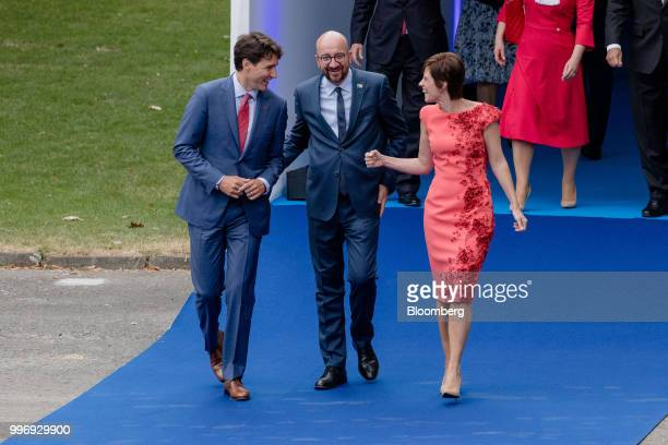 Justin Trudeau Canada's prime minister left walks with Charles Michel Belgium's prime minister center and Amelie Derbaudrenghien partner of Belgium's...