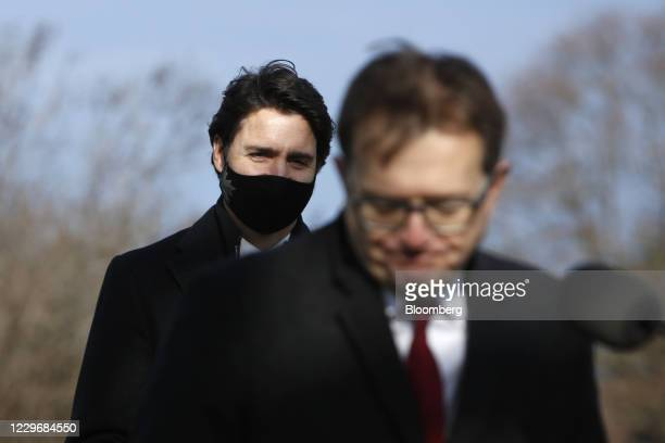 Justin Trudeau, Canada's prime minister, left, wears a protective mask while Jonathan Wilkinson, Canada's environment and climate change minister,...